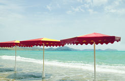 Colorful umbrellas in the beach, vintage retro style Royalty Free Stock Photo