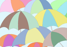 Colorful umbrellas on blue background. The colorful umbrellas on a blue background Stock Images