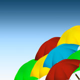 Colorful umbrellas. Colorful umbrellas on blue gradient background Stock Photo