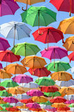 Colorful umbrellas with blue sky Stock Images
