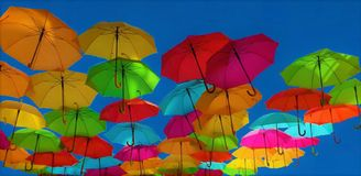 Colorful umbrellas in the blue sky, LGBT royalty free stock image
