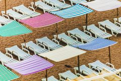 Colorful umbrellas, canopies, tents and chairs, Lagos Portugal royalty free stock photo