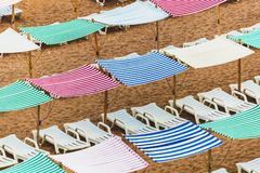 Colorful umbrellas, canopies, tents and chairs, Lagos Portugal stock images