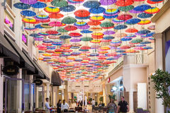 Colorful umbrellas on the ceiling. DUBAI, UNITED ARAB EMIRATES - 28 Ott, 2016: Colorful umbrellas on the ceiling of the largest mall in the world Dubai Mall UAE Stock Photography