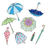 Colorful Umbrellas Collection. Of different types in various positions in hand drawn style isolated vector illustration Stock Photos