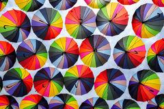 Colorful umbrellas with colors of rainbow in the blue sky Royalty Free Stock Images