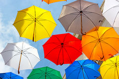 Colorful umbrellas floating against a blue sky. Royalty Free Stock Image
