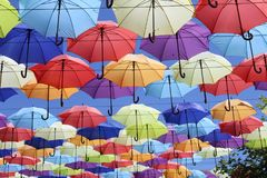 Colorful umbrellas flying in the blue sky. Summer Stock Image