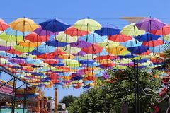 Colorful umbrellas flying in the blue sky. Summer Stock Photos