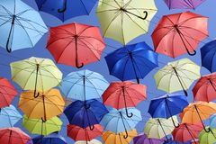 Colorful umbrellas flying in the blue sky. Summer Royalty Free Stock Photo
