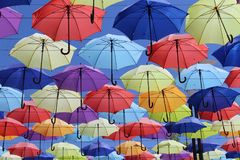 Colorful umbrellas flying in the blue sky. Summer Royalty Free Stock Image
