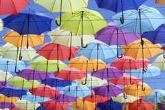 Colorful umbrellas flying in the blue sky. Summer Stock Photo
