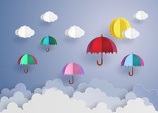 Colorful umbrellas flying high in the air. Stock Image