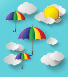 Colorful umbrellas flying high in the air. Paper cut style stock illustration