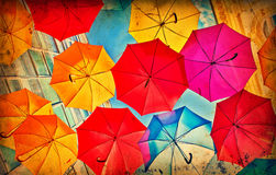 Colorful umbrellas on grunge paper Royalty Free Stock Images