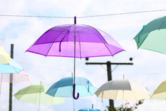 Colorful of umbrellas hang on the sky with blue sky background. Royalty Free Stock Photo
