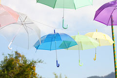 Colorful of umbrellas hang on the sky with blue sky background. Royalty Free Stock Photos