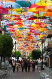 Colorful umbrellas hanging above the street in Getafe Royalty Free Stock Photos