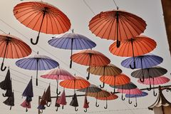 Colorful umbrellas hanging against the sky, decorating city stre Royalty Free Stock Photography