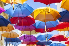 Colorful umbrellas hanging in the air royalty free stock photo