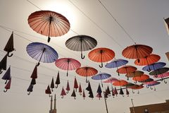 Colorful umbrellas hanging from the sky background, Yazd, Iran. Royalty Free Stock Image