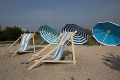 Colorful umbrellas lounge chairs Royalty Free Stock Photos