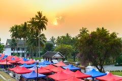 Colorful umbrellas of Luang Prabang Night market in Laos at sunrise Royalty Free Stock Photos