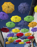 Colorful Umbrellas on Main Street Royalty Free Stock Photography