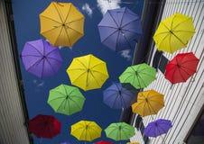 Colorful Umbrellas on Main Street Royalty Free Stock Photos