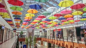 Colorful umbrellas in a mall stock photography