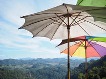 colorful umbrellas over mountains and blue sky Stock Image
