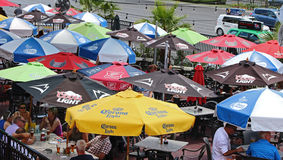 Colorful umbrellas. People eating and drinking under colorful umbrellas Royalty Free Stock Image