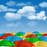 Colorful umbrellas in rain. Stock Photos