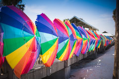 Colorful umbrellas. Rainbow colored beach umbrellas lined up in a row Stock Image