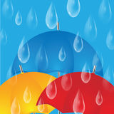 Colorful umbrellas and raindrops Stock Images
