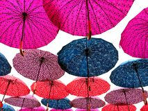 Floating colorful umbrellas stock photography