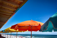 Colorful umbrellas at a restaurant by the beach Royalty Free Stock Image