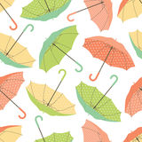 Colorful umbrellas seamless pattern. Seamless vector pattern composed of bright colorful open umbrellas; green orange and yellow shades Royalty Free Stock Images