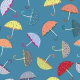 Colorful umbrellas seamless pattern. Vector illustration on blue background. Colorful umbrellas with drawn rainy drop seamless pattern. Vector illustration on stock illustration
