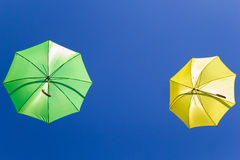 Colorful umbrellas in the sky on blue background Royalty Free Stock Photography