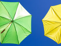 Colorful umbrellas in the sky on blue background Stock Photos