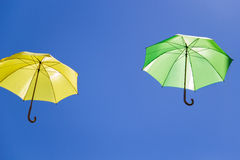 Colorful umbrellas in the sky on blue background Stock Image
