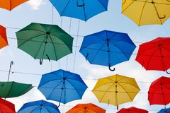 Colorful umbrellas in the sky Royalty Free Stock Photo