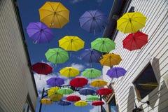Colorful Umbrellas Suspended in Alleyway Stock Photos