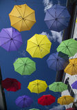 Colorful Umbrellas Suspended in Alleyway Royalty Free Stock Images