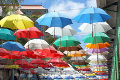 Colorful umbrellas suspended overhead Stock Photo