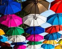 Colorful umbrellas on top of street stock images