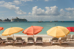 Colorful umbrellas on the tropical beach. Bright sun umbrellas on the sand beach Royalty Free Stock Photo
