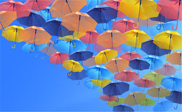 Colorful umbrellas uhodyaschii into the distance Stock Image