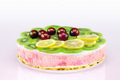 Colorful unbaked homemade fruit cake with cream and sweet cherri stock images